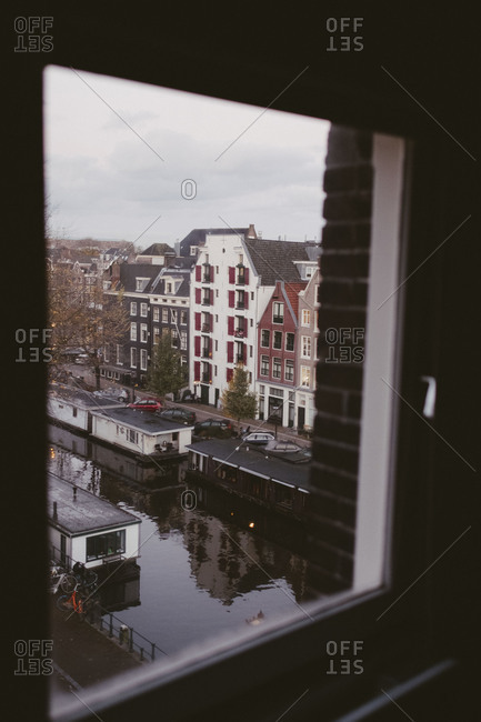 View of amsterdam canal through a window