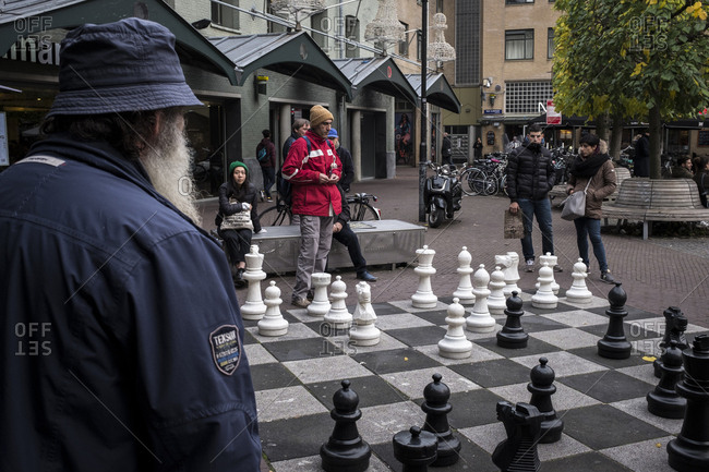 Amsterdam, Netherlands - October 28, 2016: People playing giant chess outdoors