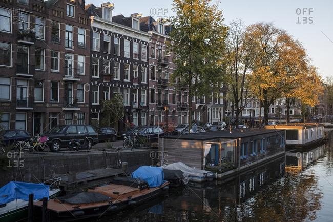 Amsterdam, Netherlands - October 29, 2016: House boats on a canal on an Fall day