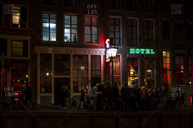 Amsterdam, Netherlands - October 29, 2016: People exploring the red light district at night