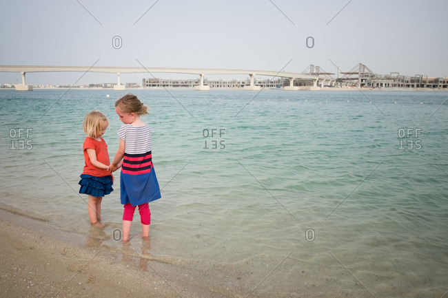 Two girls playing in the gulf on a beach in Dubai