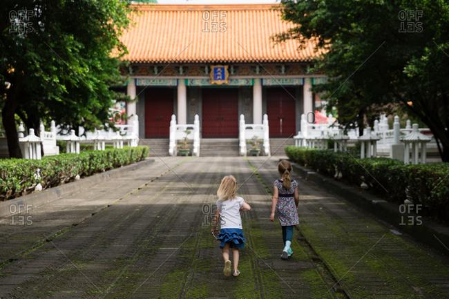 Sisters walking toward a building in Taiwan