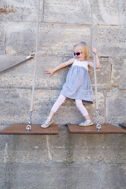 Little girl walking on wooden platforms
