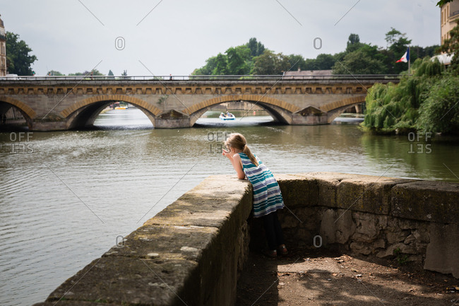 Girl looking over bridge in France