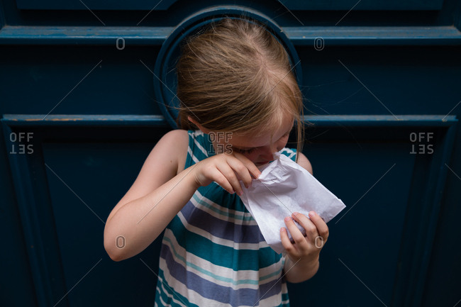 Little girl looking into a paper bag