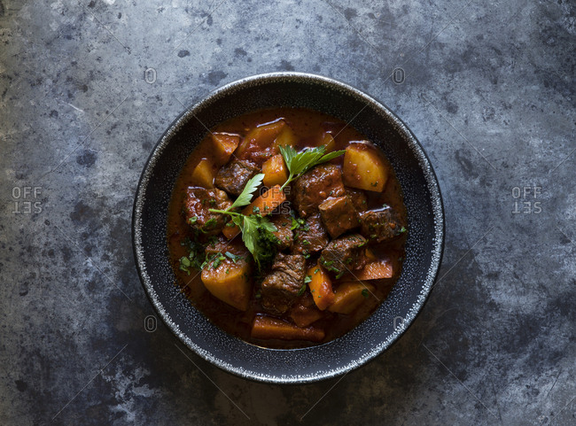 Overhead view of beef stew with carrots and potatoes