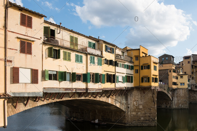 Ponte Vecchio in daylight and the colorful external facades of the jewelry shops on Arno river, Florence, Tuscany, Italy