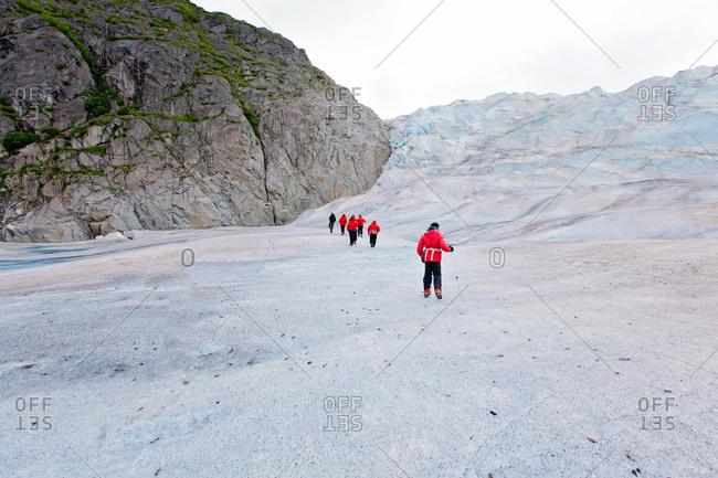 Group of travelers in icy Alaska
