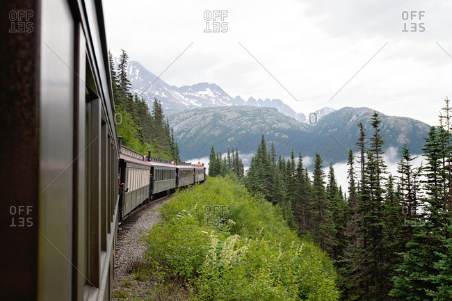 Train boxcars going around bend in Alaska