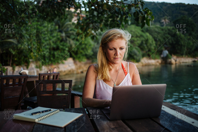 Remote worker typing on computer