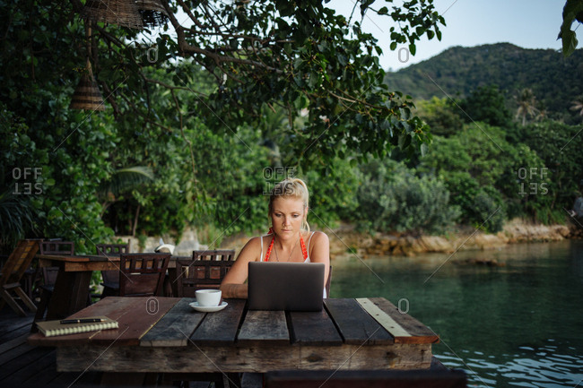 Remote working woman concentrating at laptop