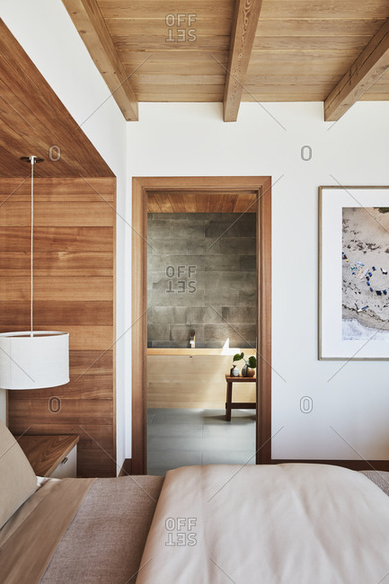 Malibu, California - March 15, 2017: Looking into en suite bathroom from a modern master bedroom designed by Chad Eisner