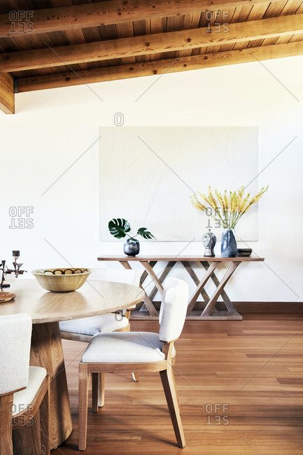 Malibu, California - March 15, 2017: Chad Eisner designed modern interior of dining room furniture at a beach house