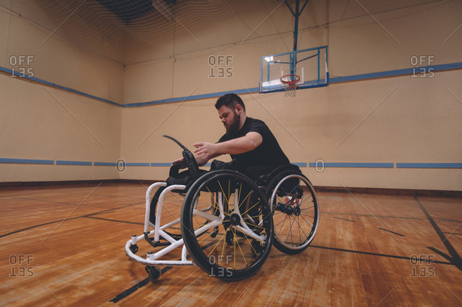 Disabled man operating wheelchair in the court
