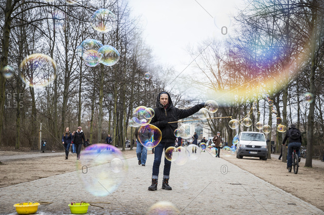 Berlin, Germany - March 16, 2017: A street performer blowing soap bubbles in the Tiergarten