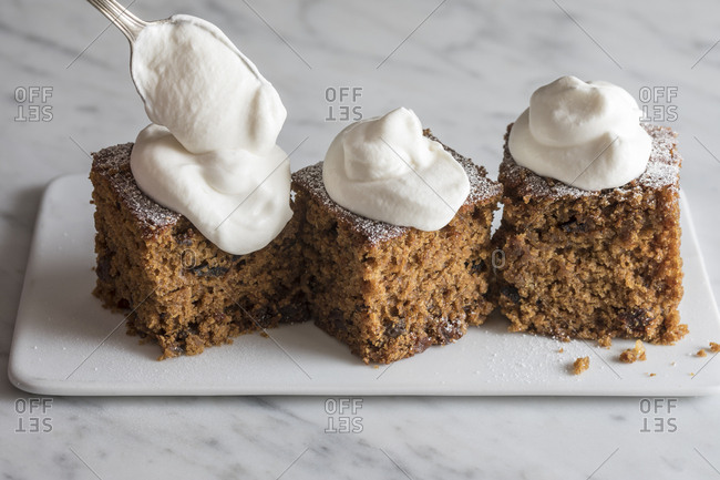 Gingerbread with whipped cream spooned on top