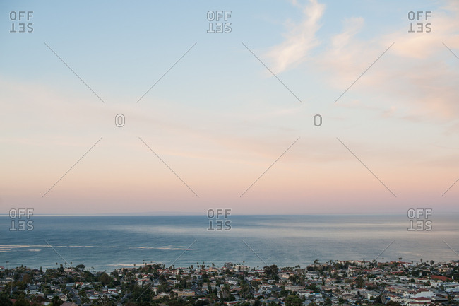 Sunset over city on the coast of the Pacific Ocean