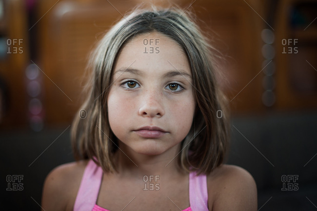 Young girl inside a boat with sidelight looking thoughtful