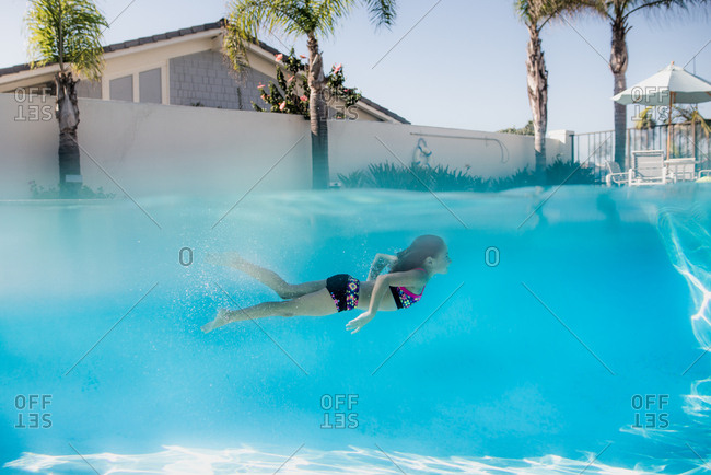 Girl swimming underwater pool