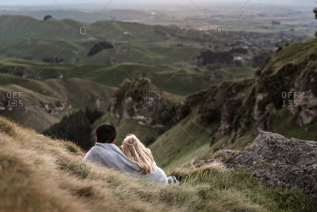 Kids wrapped in a blanket enjoying mountain view in New Zealand