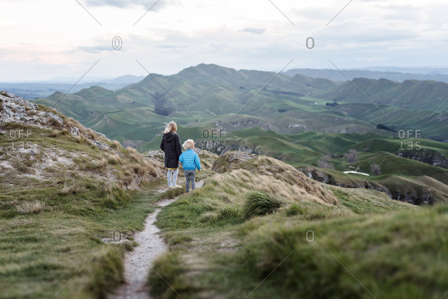 Two kids exploring a mountain in New Zealand