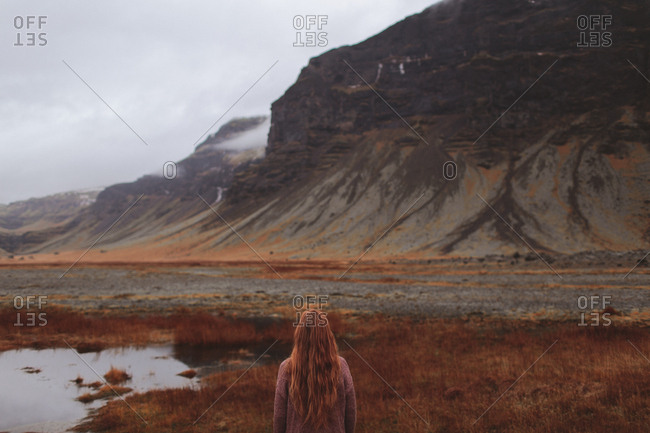 Girl looking at vast landscape, Iceland