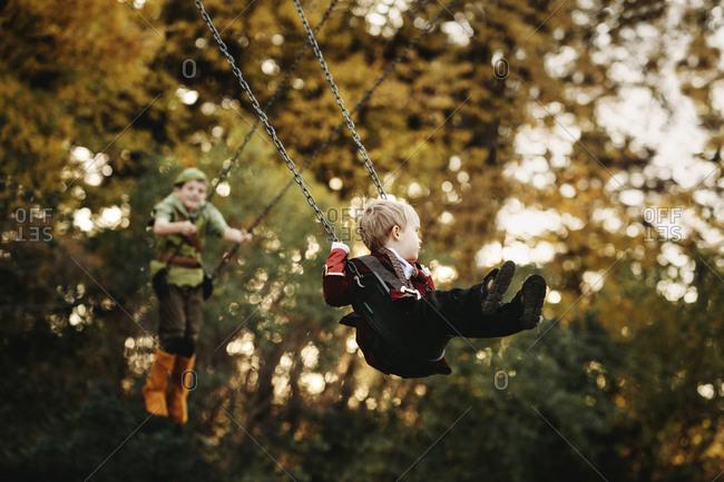 Boys swinging in costumes