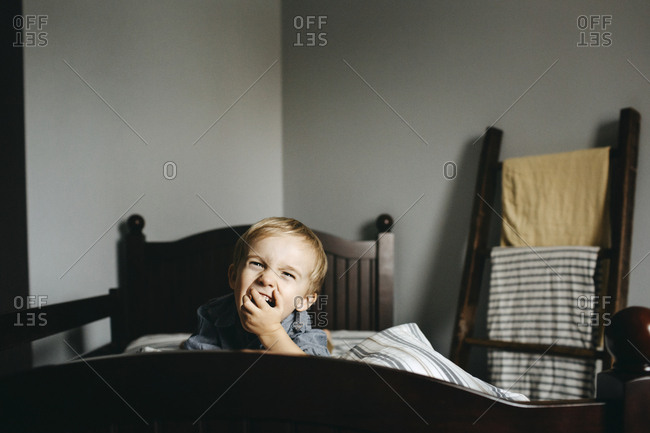 Little boy on bed laughing