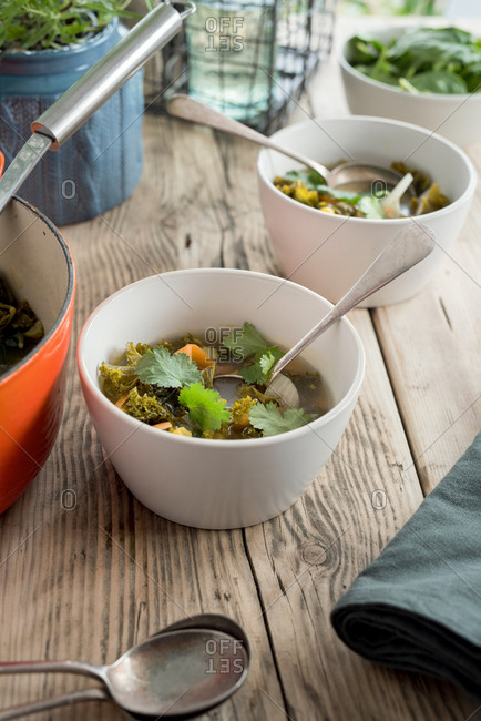 Healthy diet soup in a bowl on a kitchen table