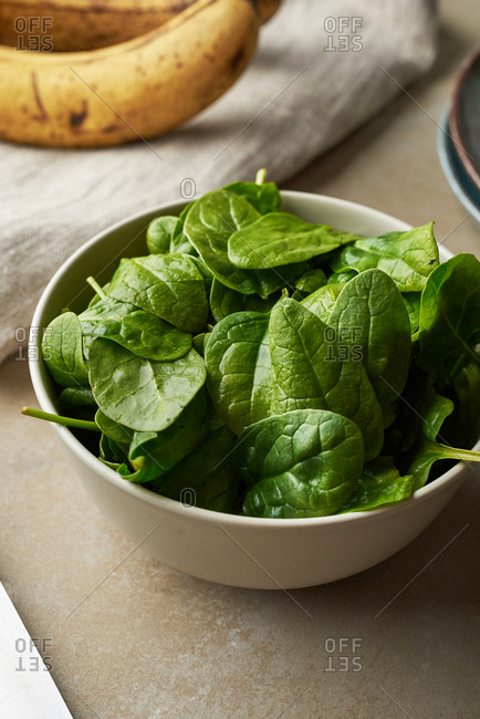 Bowl filled with fresh spinach