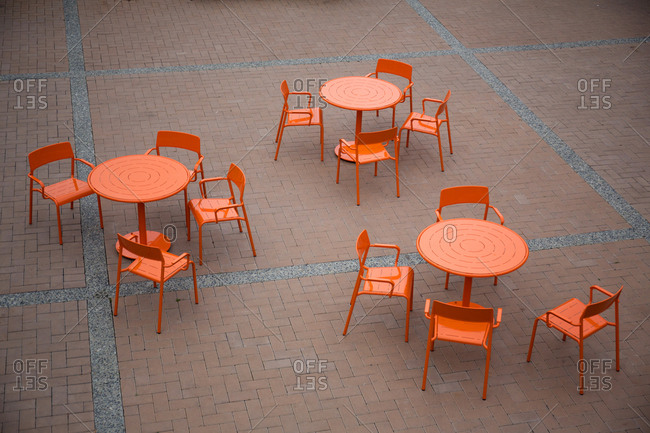 Empty courtyard chairs and tables