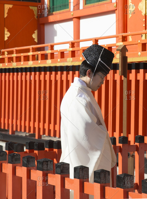 Kyoto, Japan - November 30, 2015: Buddhist priest praying near temple