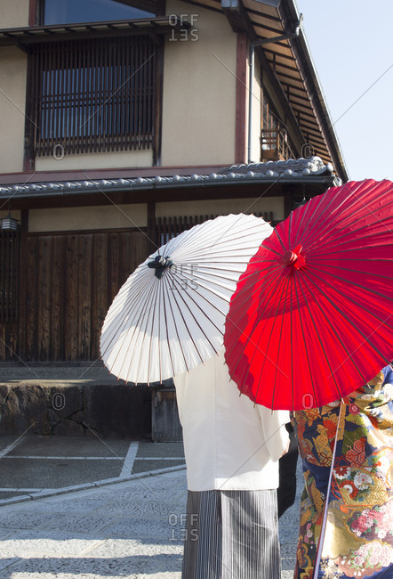 Japanese man and woman with traditional paper umbrellas