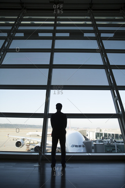 Man looking out airport window