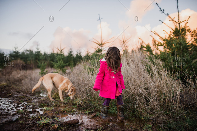 Girl wandering outdoors with her dog