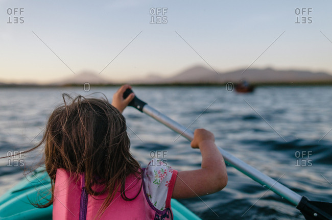 Small girl rowing boat in the lake