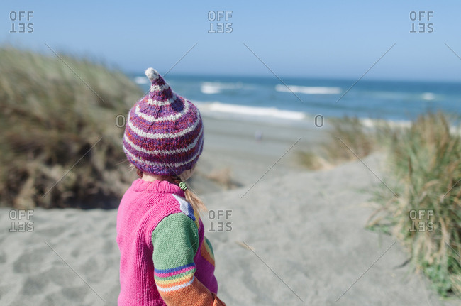 Girl staring at ocean alone