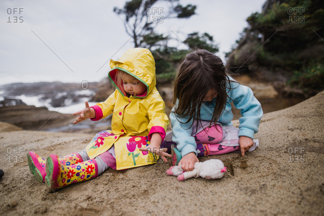 Two sisters playing content in the sand