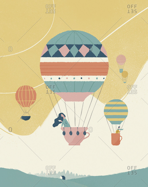 Woman ballooning with hot-air balloon in shape of a cup