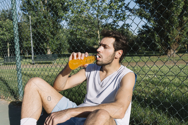 Basketball player drinking from bottle
