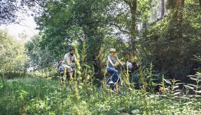 Family riding bicycle in a forest