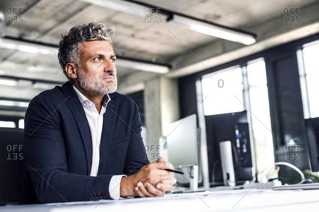 Mature businessman in office thinking