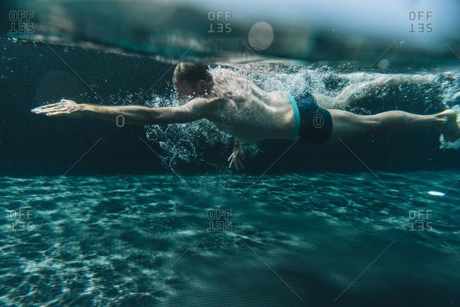 Man swimming in a swimming pool