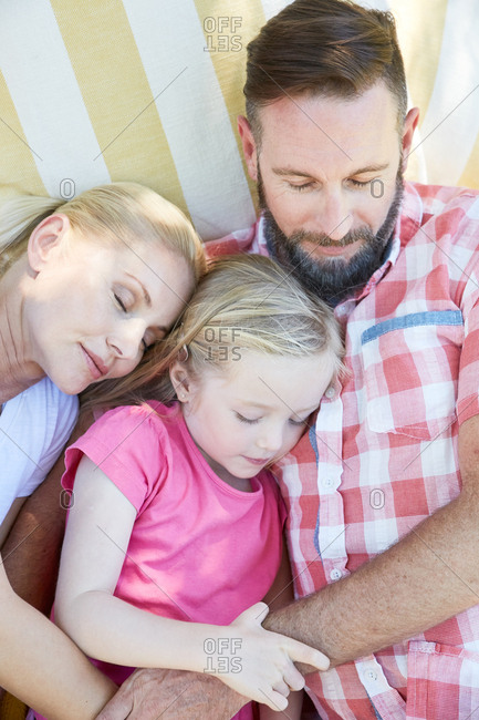 Family relaxing lying on a blanket