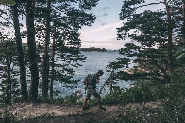 Russia- Far East- Khasanskiy- Japanese sea- man hiking at Telyakovsky bay