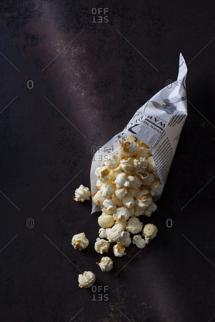 Paper bag of popcorn on rusty background