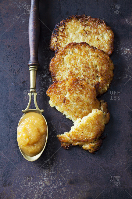 Potato fritters and spoon of apple sauce