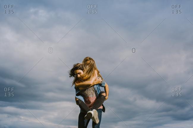 Couple enjoying piggyback ride together