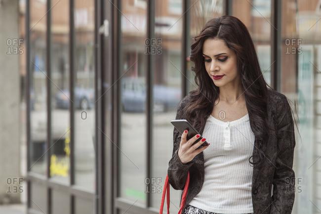Woman looking at a smart phone in Blekinge, Sweden