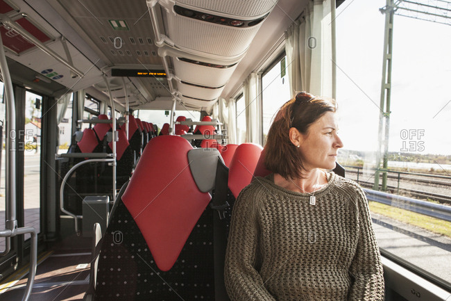 Woman sitting on a train